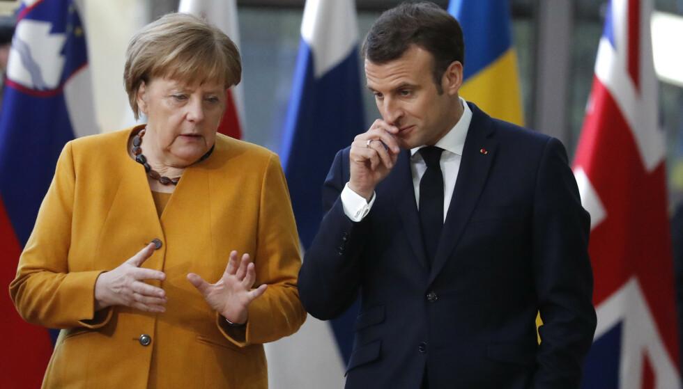 MØTES: Angela Merkel og Emmanuel Macron her fra et møte tidligere i år. Foto: Frank Augstein AP / NTB Scanpix.