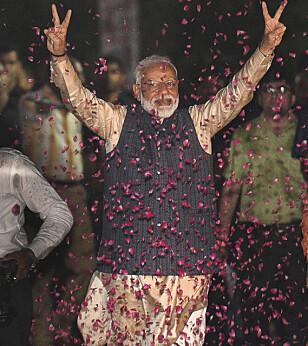 Indias statsminister hindunasjonalistiske statsminister Narendra Modi vant en overveldende seier i valget på ny nasjonalforsamling. Foto: AP / NTB scanpix