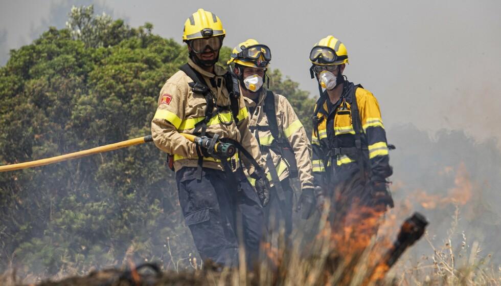 Flere tusen hektar skog har gått opp i flammer i Torre del Espanol-området sørvest for Barcelona. Foto: AP / NTB scanpix