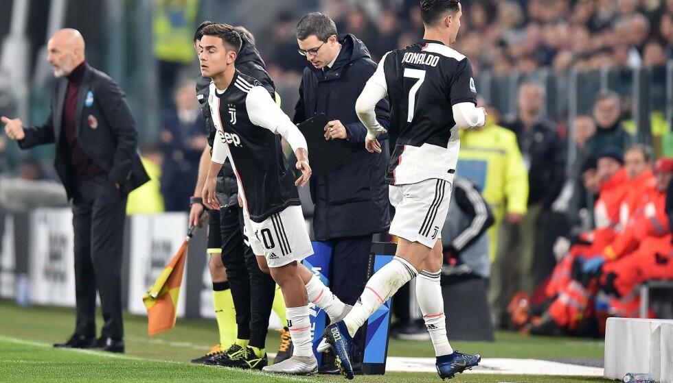 Juventus' Cristiano Ronaldo (nummer sju) og Paulo Dybala i søndagens Torino-derby. Foto: Alessandro Di Marco, AP / NTB scanpix