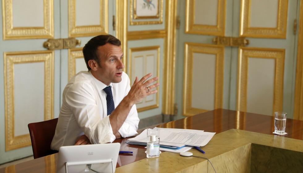 Frankrikes president Emmanuel Macron sier det er gråsoner i Kinas håndtering av virusutbruddet og at det har skjedd ting «vi ikke vet om». Foto: Yoan Valat via AP / NTB scanpix