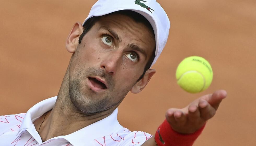 Serbia's Novak Djokovic serves the ball to Germany's Dominik Koepfer during their quarterfinal match at the Italian Open tennis tournament, in Rome, Saturday, Sept. 19, 2020. (Alfredo Falcone/LaPresse via AP)
