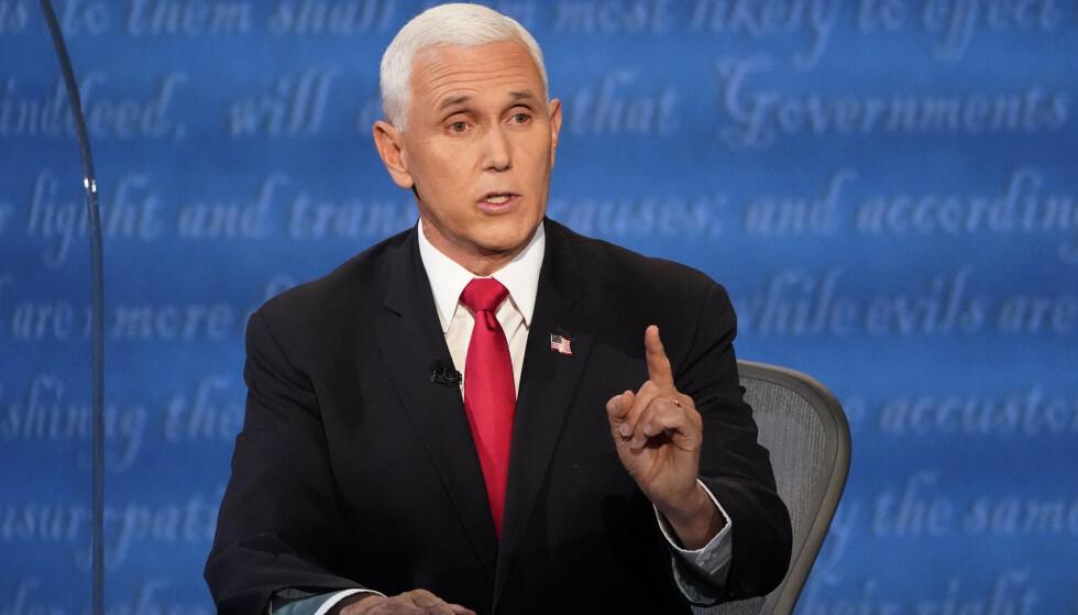 Visepresident Mike Pence ble avbrutt under debatten da han kritiserte Kina. Foto: Julio Cortez / AP / NTB