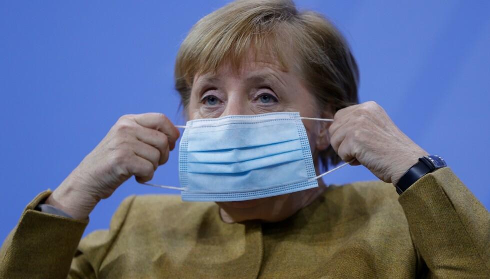 Statsminister Angela Merkel har fått delstatene til å stenge ned til over nyttår. Photo by Odd Andresen/ POOL / AFP