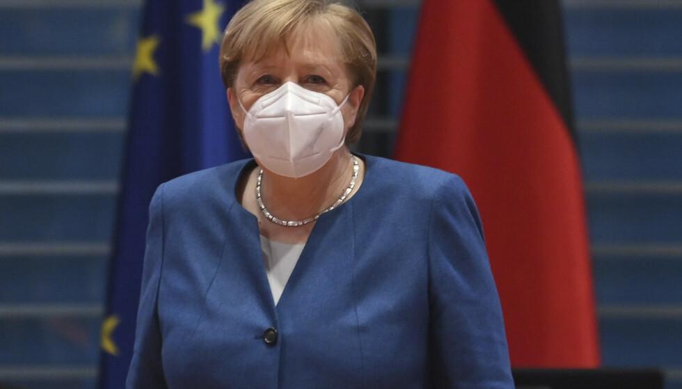 Statsminister i Tyskland, Angela Merkel reagerer med sinne etter onsdagens demonstrasjoner. Foto: John MacDougall/Pool via AP.