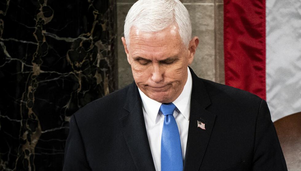 USAs visepresident Mike Pence har ikke utelukket å ta i bruk det 25. grunnlovstillegget og felle president Donald Trump, opplyser en kilde nær ham til CNN. Foto: Erin Schaff / The New York Times via AP, Pool / NTB