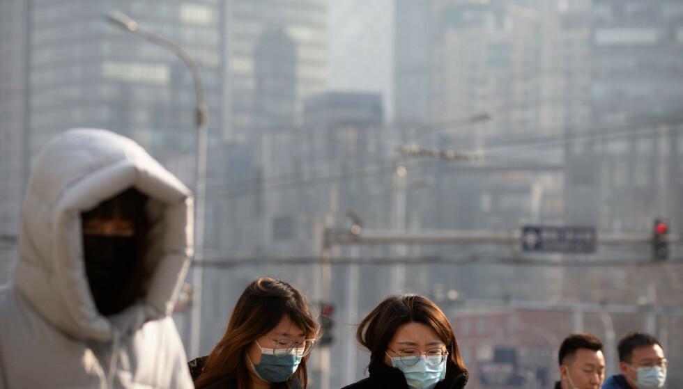 Fem nabolag i Beijing får strengere coronatiltak i tiden fremover. Foto: Mark Schiefelbein / AP / NTB