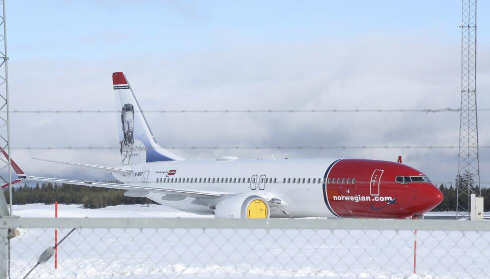 18 av Norwegians fly er Boeing 737 MAX 8, flytypen som onsdag fikk opphevet flyforbudet etter nesten to år på bakken. Om Norwegian vil fortsette å bruke disse flyene på lang sikt er derimot ikke avklart. Foto: Vidar Ruud / NTB