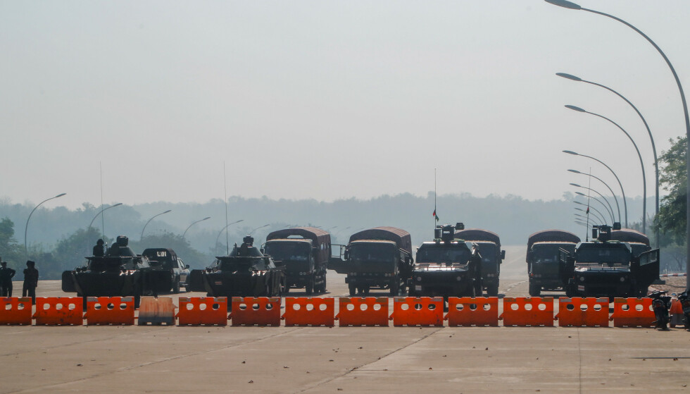 Myanmar's military stand guard at a checkpoint manned with armored vehicles blocking a road leading to the parliament building Tuesday, Feb. 2, 2021, in Naypyitaw, Myanmar. Hundreds of members of Myanmar's Parliament remained confined inside their government housing in the country's capital on Tuesday, a day after the military staged a coup and detained senior politicians including Nobel laureate and de facto leader Aung San Suu Kyi. (AP Photo)