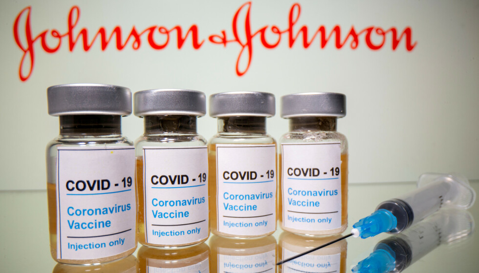 """FILE PHOTO: Vials with a sticker reading, """"COVID-19 / Coronavirus vaccine / Injection only"""" and a medical syringe are seen in front of a displayed Johnson & Johnson logo in this illustration taken October 31, 2020. REUTERS/Dado Ruvic/Illustration/File Photo/File Photo/File Photo"""