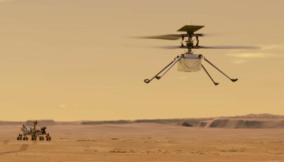 Slik ser Nasa for seg Ingenuity på flytur over Mars. Den første prøveflygingen skjer tidligst på søndag. Illustrasjon: Nasa/JPL-Caltech / AP / NTB