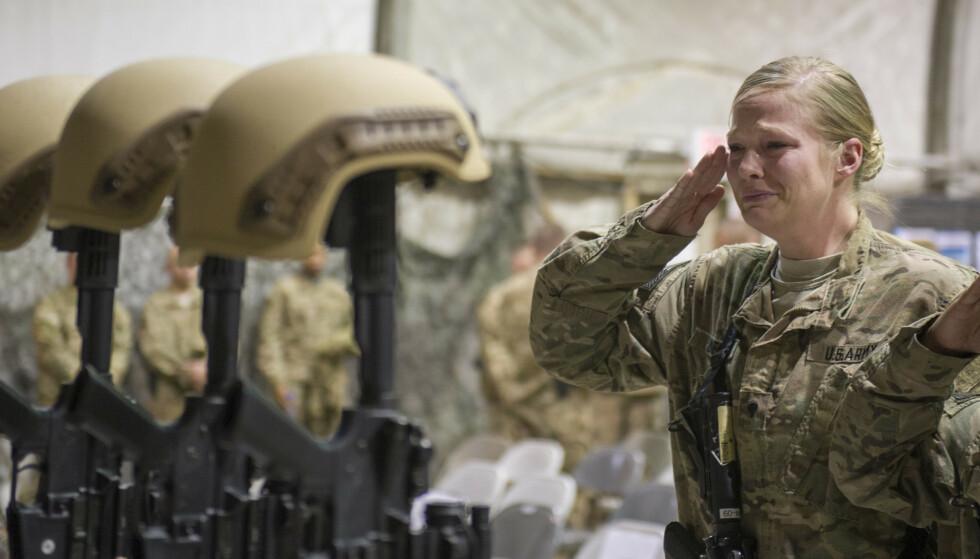 USAs lengste krig har kostet 2.442 amerikanske soldater og anslagsvis 3.800 amerikanere ansatt i private sikkerhetsselskap livet. 1.144 soldater fra andre land er også drept, blant dem ti norske. Foto: AP / NTB