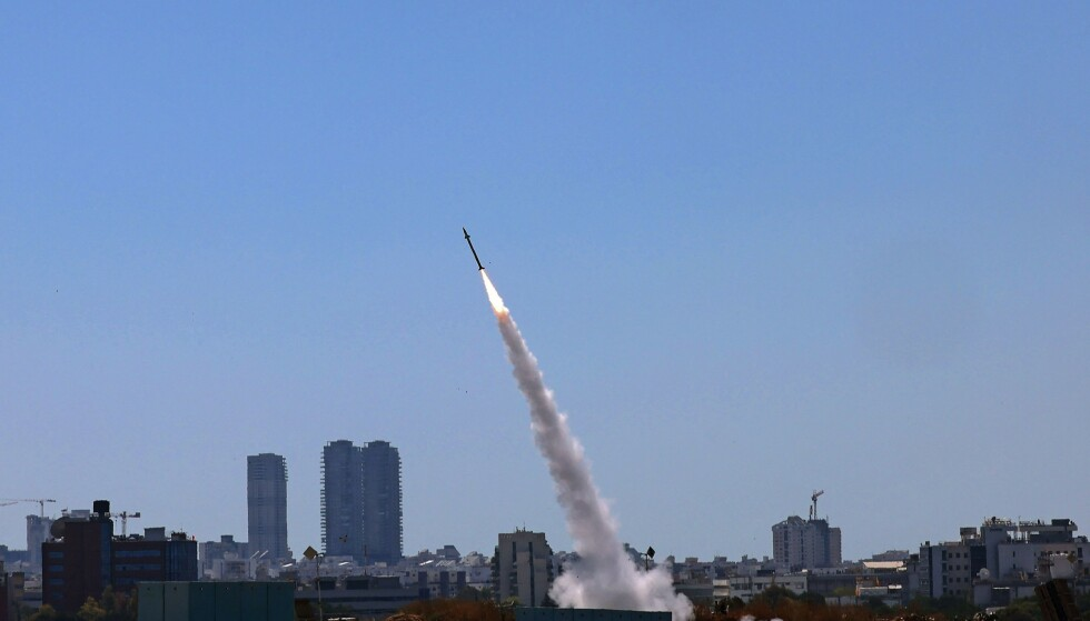 Israel's Iron Dome aerial defence system is activated to intercept a rocket launched from the Gaza Strip, controlled by the Palestinian Hamas movement, above the southern Israeli city of Ashdod, on May 12, 2021. (Photo by EMMANUEL DUNAND / AFP)a