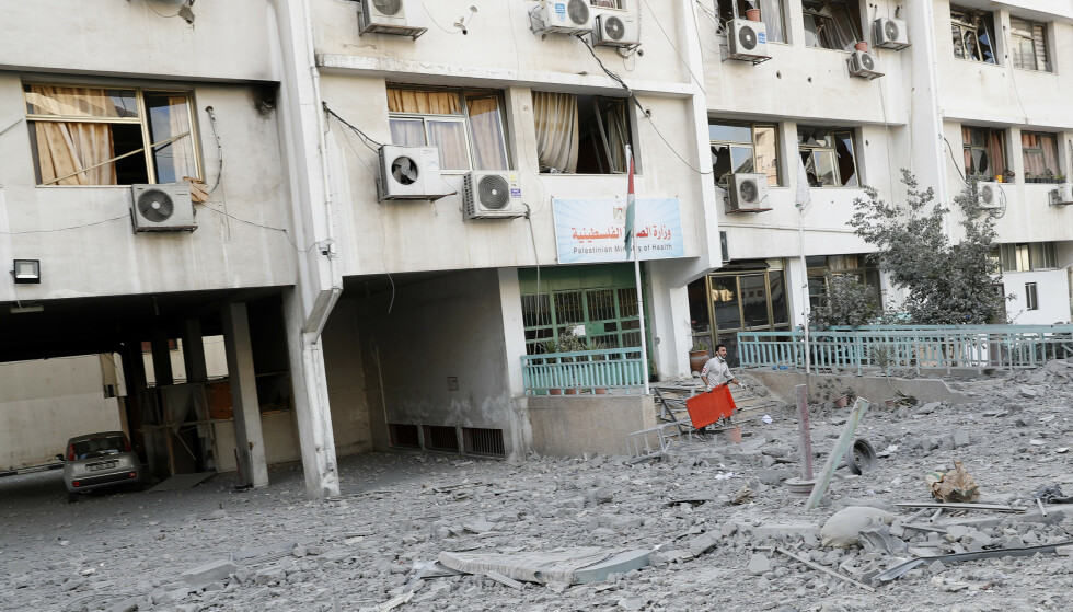 A medic inspects the rubble of a Gaza health care clinic following an Israeli airstrike on the upper floors of a commercial building near the  Health Ministry in Gaza City, Monday, May 17, 2021. (AP Photo/Adel Hana)