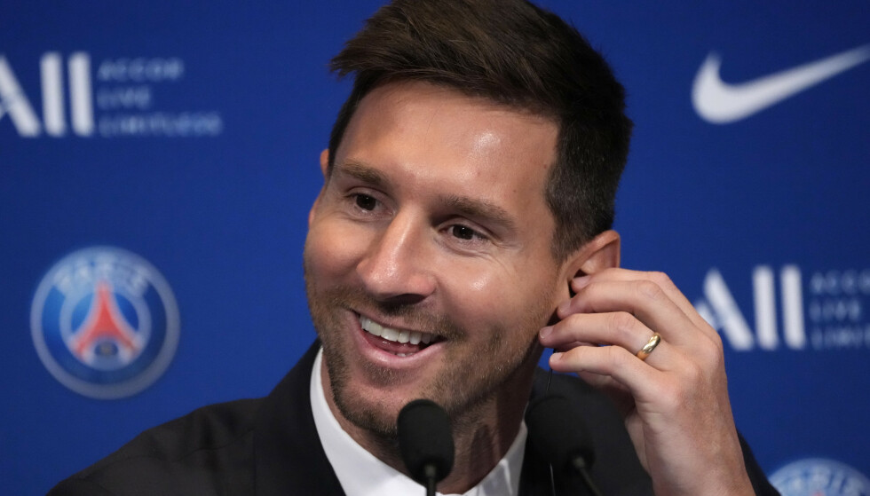 """Lionel Messi attends a press conference Wednesday, Aug. 11, 2021 at the Parc des Princes stadium in Paris. Lionel Messi said he's been enjoying his time in Paris """"since the first minute"""" after he signed his Paris Saint-Germain contract on Tuesday night. The 34-year-old Argentina star signed a two-year deal with the option for a third season after leaving Barcelona. (AP Photo/Francois Mori)"""