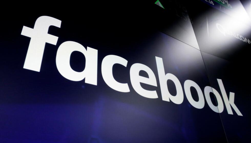 Facebook-logo på skjermer i New York. Foto: Richard Drew / AP / NTB
